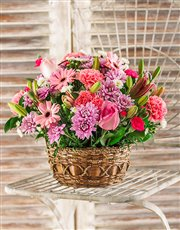A mix of pink lilies, gerberas, roses, carnations