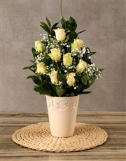 Roses arranged in ceramic pot. A stylish statement