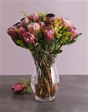Send this vase filled with exquisite Proteas to so