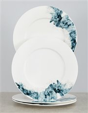 This Carrol Boyes Moody Bloom dinner plate set is