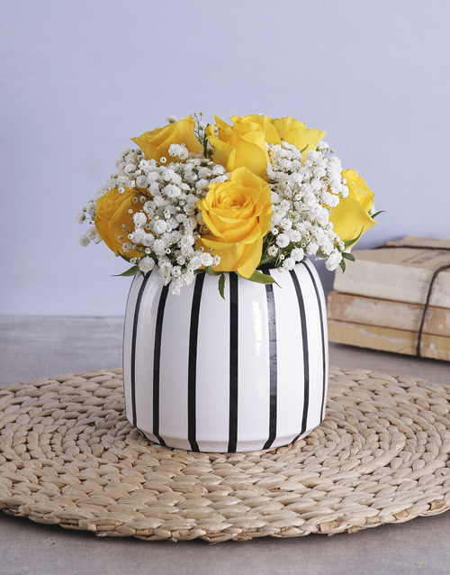 colour: Yellow Roses in a black and white vase!