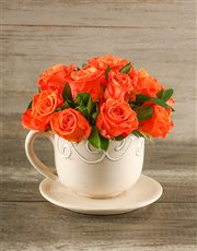 Picture of Orange Roses in a Teacup!