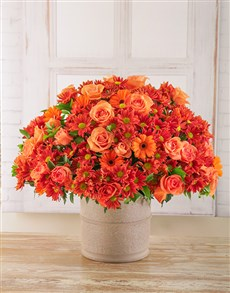 flowers: Orange Sprays, gerberas and roses in Pottery Pot!