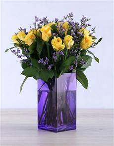 flowers: Yellow Roses in a delightful purple vase!
