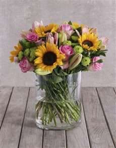 flowers: Bright Mix of Sunflowers in a Large Glass Vase!