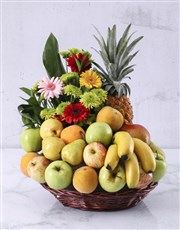A basket filled with fresh fruit and seasonal flow