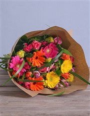 A bouquet of mixed roses & gerberas wrapped in bro