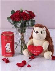 Red Roses in Carafe Vase