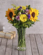 A mixed seasonal vase of colourful and bright flow