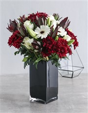 Red and White Flowers in Black Vase