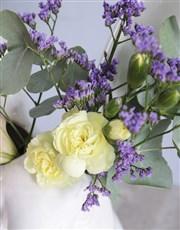 Mixed Flowers in Hopping Ceramic Vase