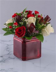 Vase of Red and Cream Roses