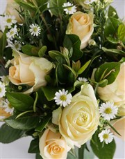 Enchanting Cream Roses In Green Vase