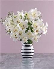 St Joseph Lilies in Striped Vase