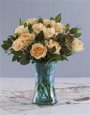 Peach Roses In Blue Cylinder Vase