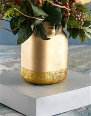 Cream Roses with Hypericum in Gold Jar