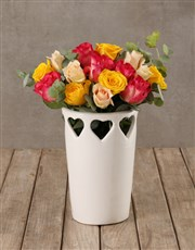 Vibrant Blooms in Cut Out Heart Vase