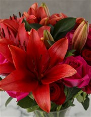 Elegant Red and Cerise Lilies and Roses