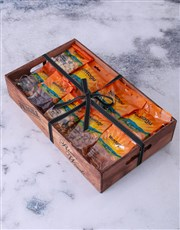 A wooden crate containing 800g of assorted dried f