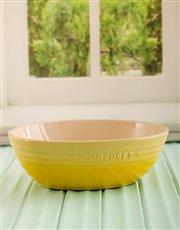 Buy a beautiful pasta bowl in bright lemon yellow