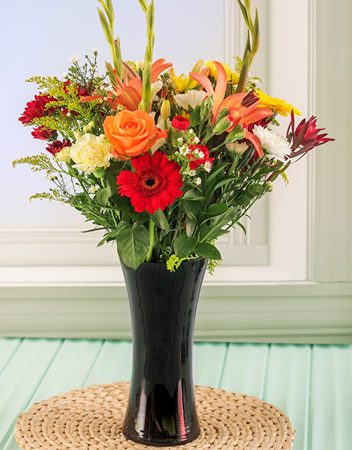 year-end: Mixed Flowers in a Tall Black Vase!
