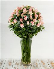 Picture of 100 Pink Roses in a Tall Glass Vase!
