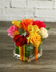 flowers: Rainbow Roses in Decorated Square Vase!