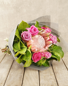 flowers: Captivating Protea and Rose Bouquet!