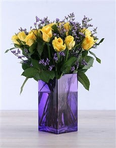 gifts: Yellow Roses in a delightful purple vase!