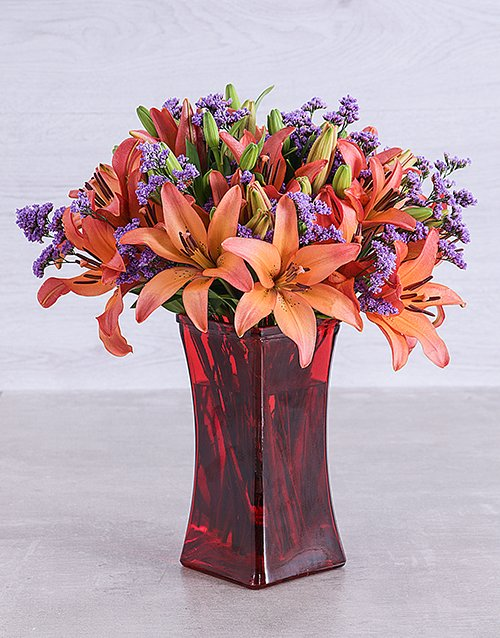 vase: Sunset Lilies and Latifolia in a Red Square Vase!