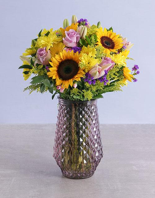 colour: Assorted Classic Flowers In Purple Vase!